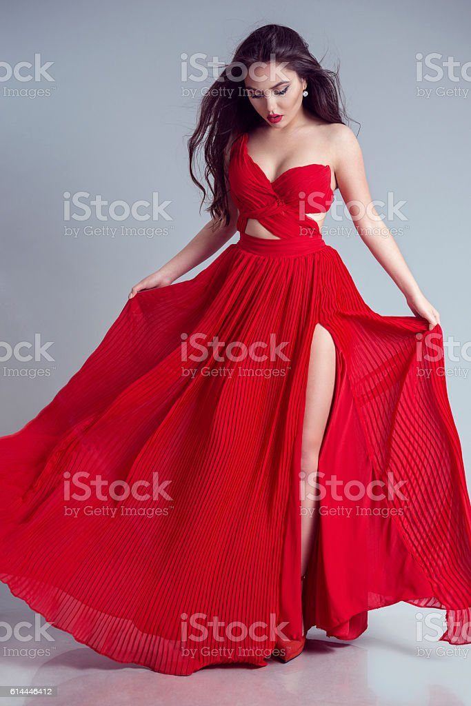 Woman Red Dress, Fashion Model in Long Gown Turning stock photo