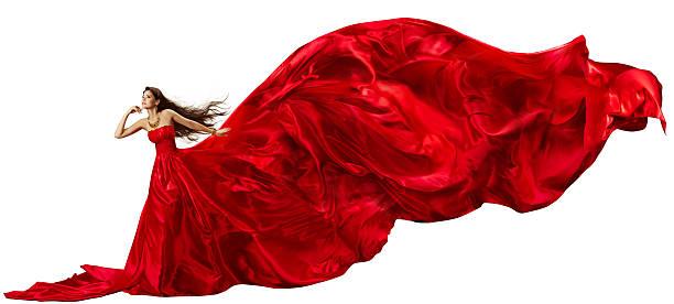 frau im roten kleid mit fliegenden seide stoff tuch winken und verführerischen - lange abendkleider stock-fotos und bilder