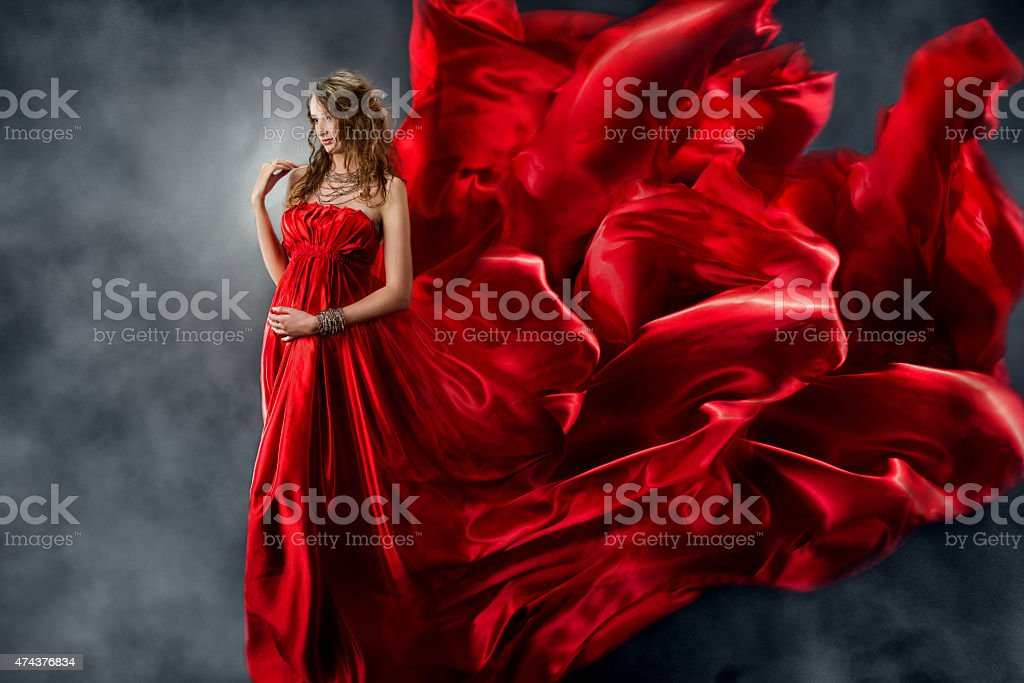 Woman Red Dress Flying Wind, Fashion Waving Fluttering Silk Cloth stock photo