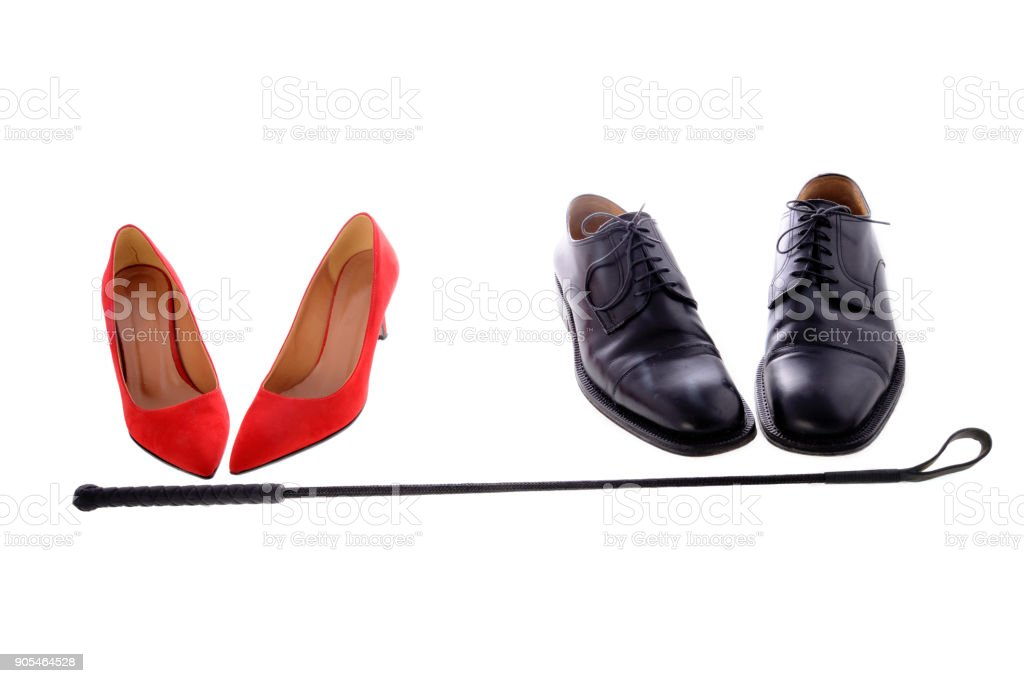 Woman red high heels for sado-masochism stock photo