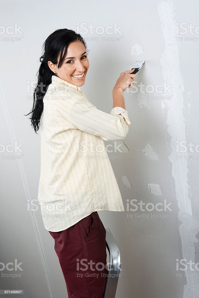 Woman redecorating home stock photo