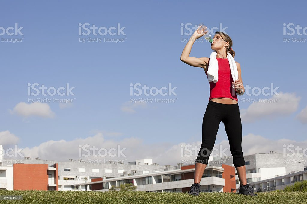 woman refreshing after the exercise royalty-free stock photo