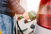 istock Woman refueling her small silver car 626195358