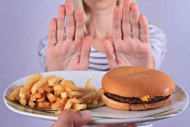 Woman refuses to eat junk food . stock photo