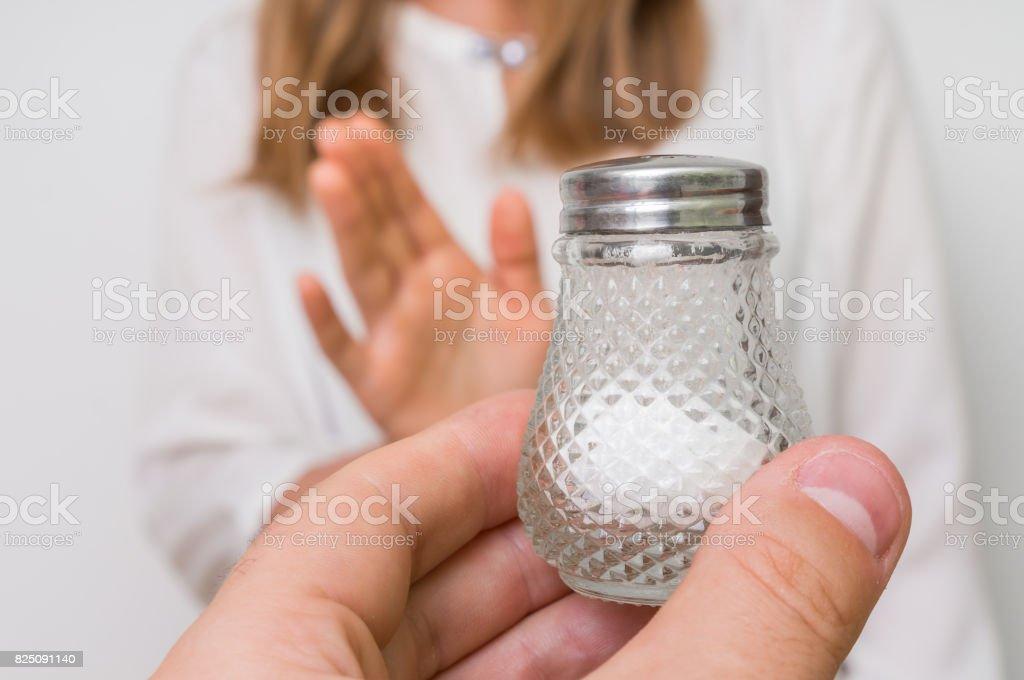 Woman refusing salt using gesture stop stock photo