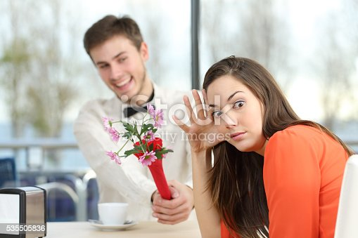 istock Woman rejecting a geek boy in a blind date 535505836