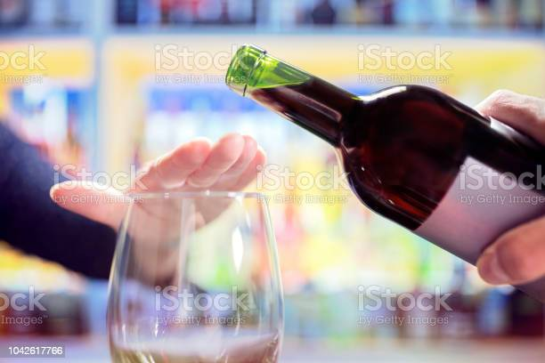 Woman rejecting more alcohol from wine bottle in bar picture id1042617766?b=1&k=6&m=1042617766&s=612x612&h=c5jc3 ljnmx3abiqfdfx6vsway1xao3ffmulhe cvry=