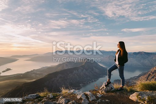 woman relax in mountains at sunset with beautiful view. Picturesque landscape background.
