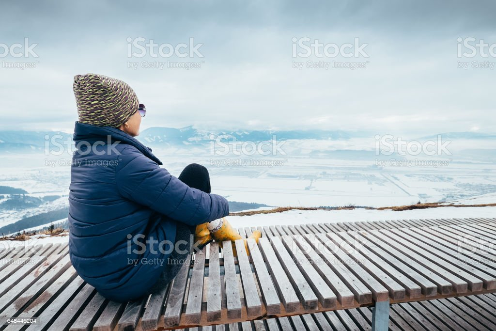 Woman relax in top view point with mountain city winter panorame stock photo