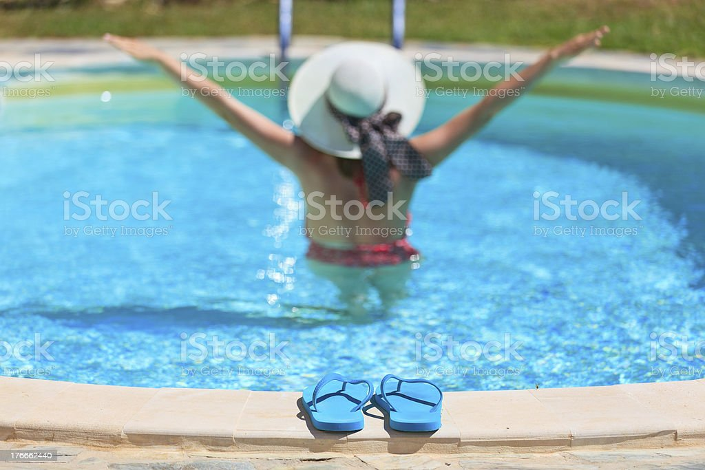 woman relaxed at the pool, vacation concept royalty-free stock photo