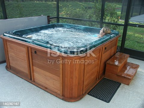 woman relaxing in the hot tub