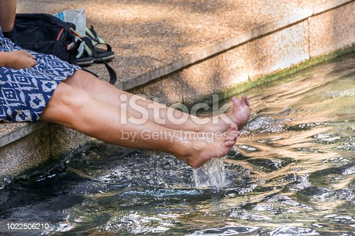 522909925 istock photo Woman relaxes by the resort spa water park and sitting 1022506210