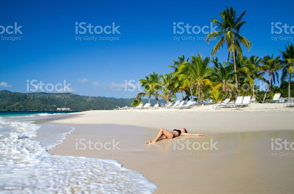 woman relaxes on beach royalty-free stock photo