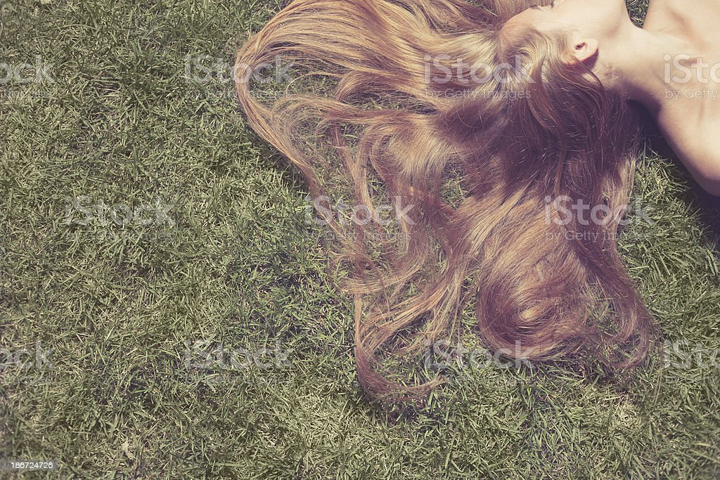 woman relaxes on the grass royalty-free stock photo