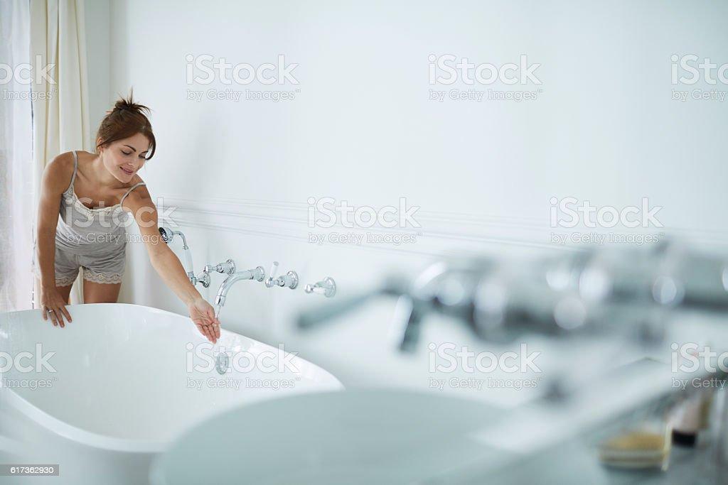 Woman relaxing a luxury bathroom. stock photo