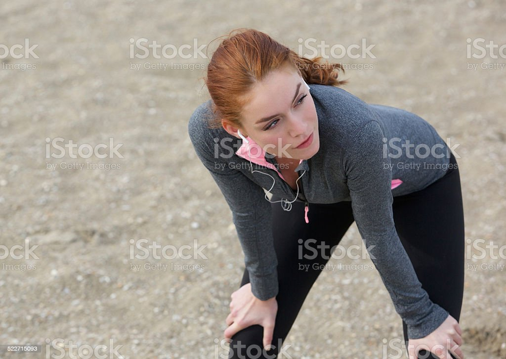Woman relaxing after exercise work out stock photo