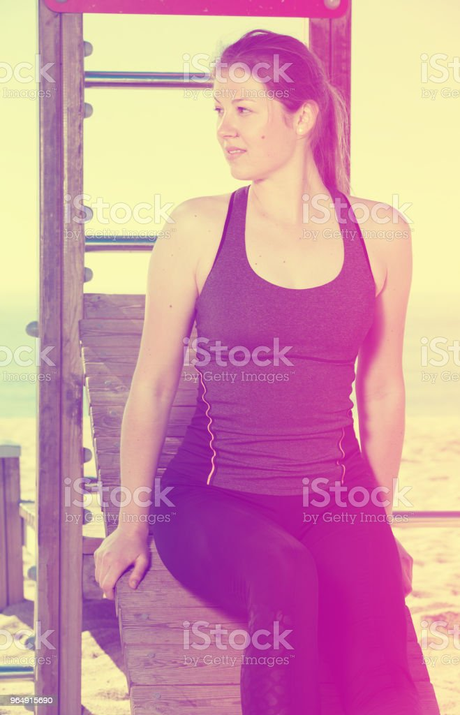 Woman relaxing after workout outdoors royalty-free stock photo