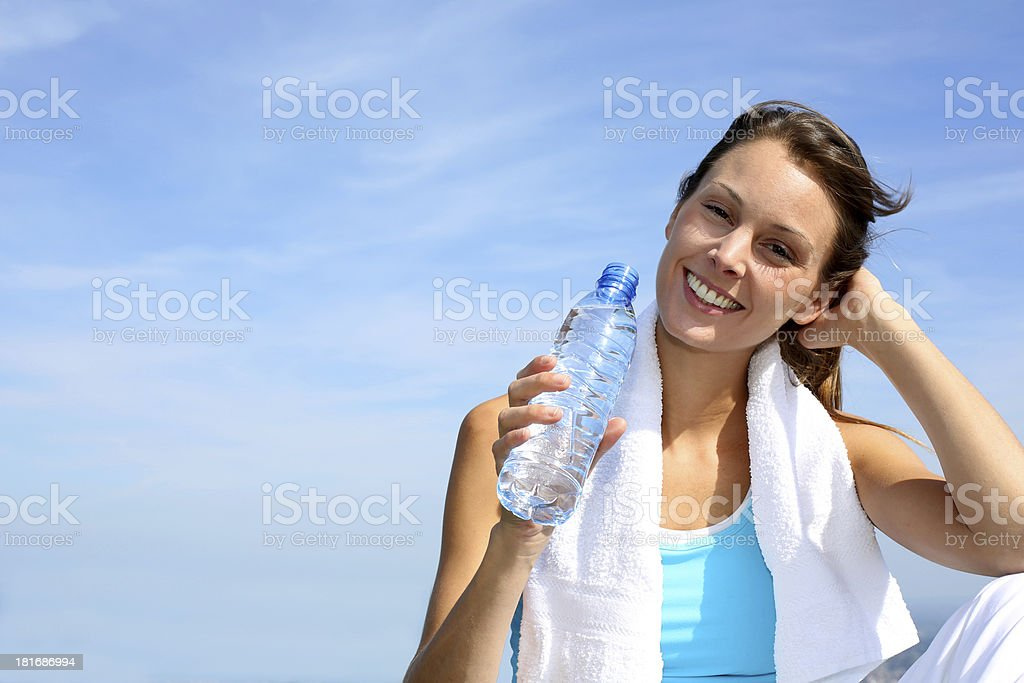 Woman relaxing and drinking water after sport royalty-free stock photo