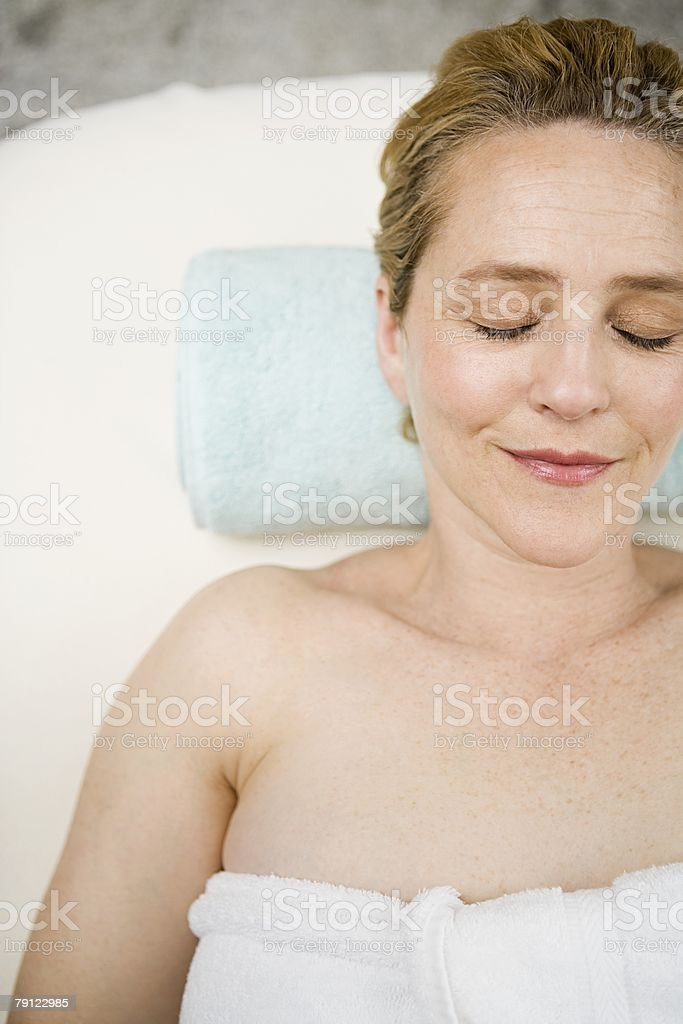 Woman relaxing at a health spa 免版稅 stock photo
