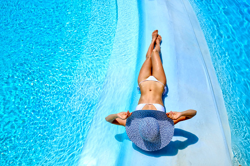 woman relaxing at a resort swimming pool