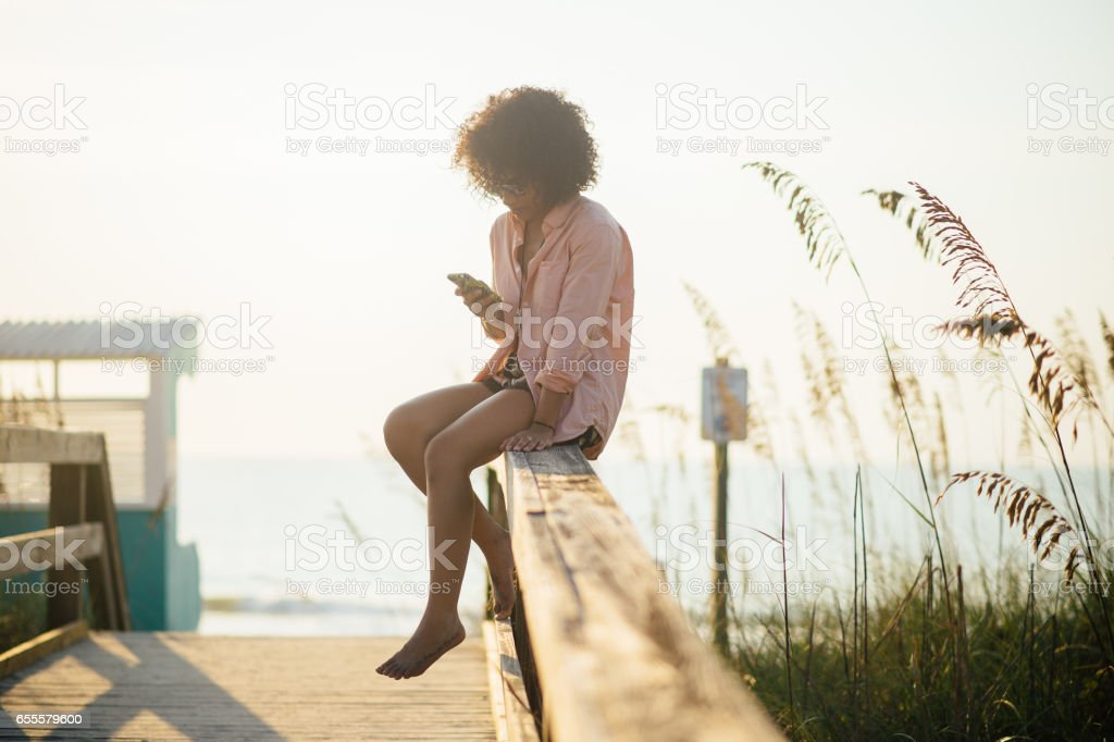 Woman Relaxing at Beach stock photo
