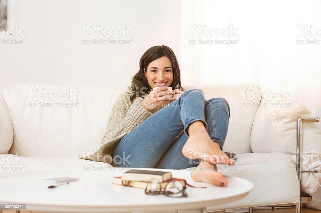 Woman relaxing at home stock photo