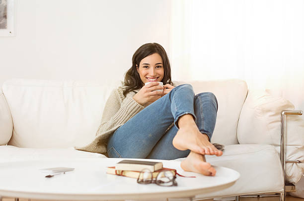 woman relaxing at home - warm house stock photos and pictures