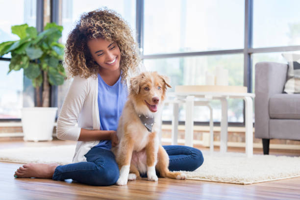 Woman relaxing at home with adorable puppy picture id1016654690?b=1&k=6&m=1016654690&s=612x612&w=0&h=wx7uap0saa yl9alkfg51fcnyf8ssohbgbdaifgxbbw=