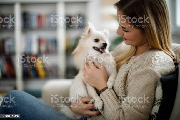 Woman relaxing at home with her dog picture id943315926?b=1&k=6&m=943315926&s=612x612&h=szrig7td9kwagrghipwj2cmtxehb1qlhsuojkqbjuye=