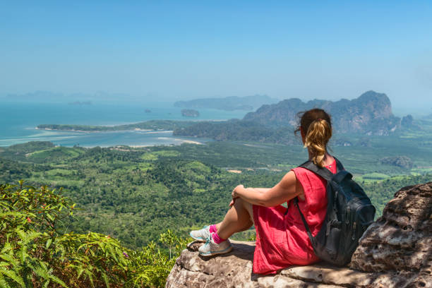 Woman relaxing at mountain top in Thailand stock photo