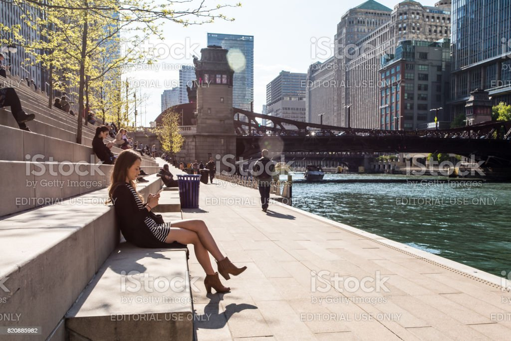 Woman relaxing at Riverwalk in Chicago stock photo