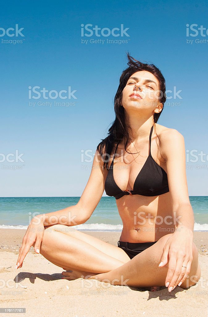 Woman relaxing at the beach in summer time royalty-free stock photo
