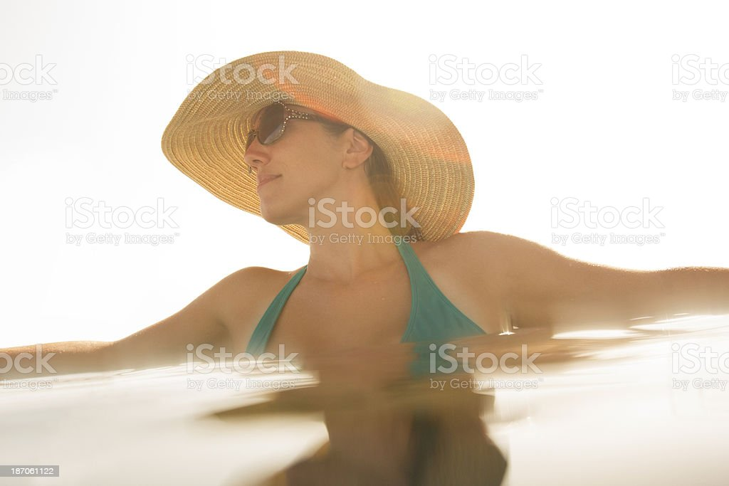 Woman Relaxing At The Edge Of Infinity Pool royalty-free stock photo