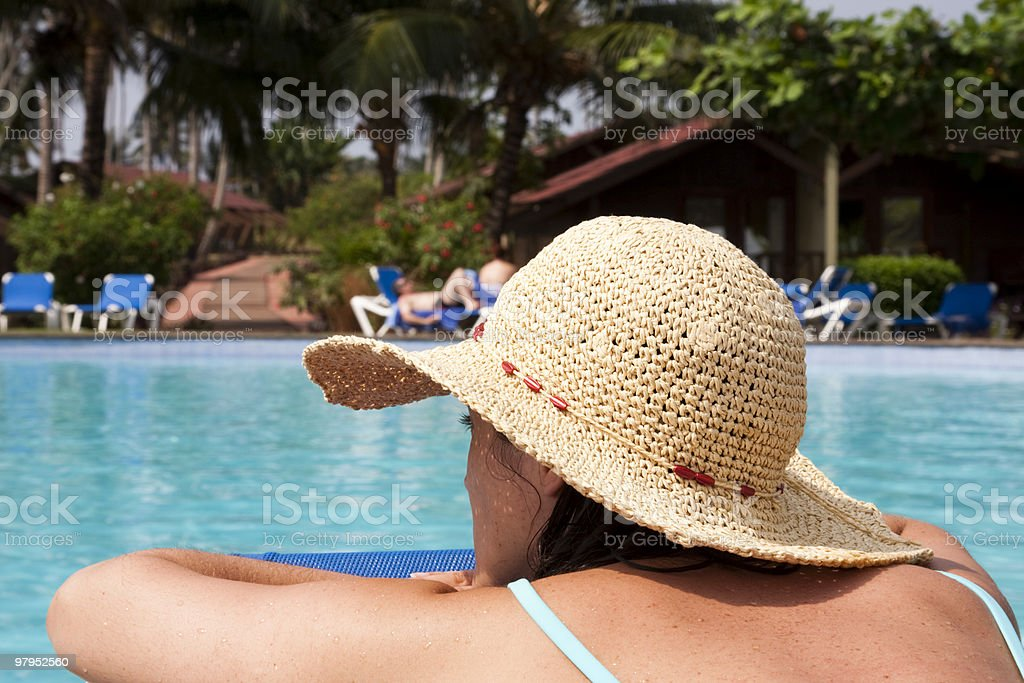 woman relaxing at the pool royalty-free stock photo