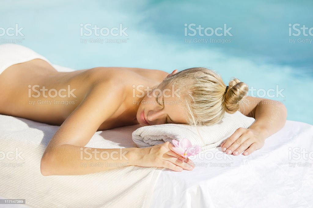 woman relaxing at the spa ready for a massage treatment royalty-free stock photo