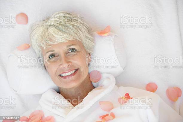 Woman relaxing at the spa surrounded by rose petals picture id529695817?b=1&k=6&m=529695817&s=612x612&h=p1flx9mz9aow ofrgcxt5lqzuala5khuzjxl11wotme=