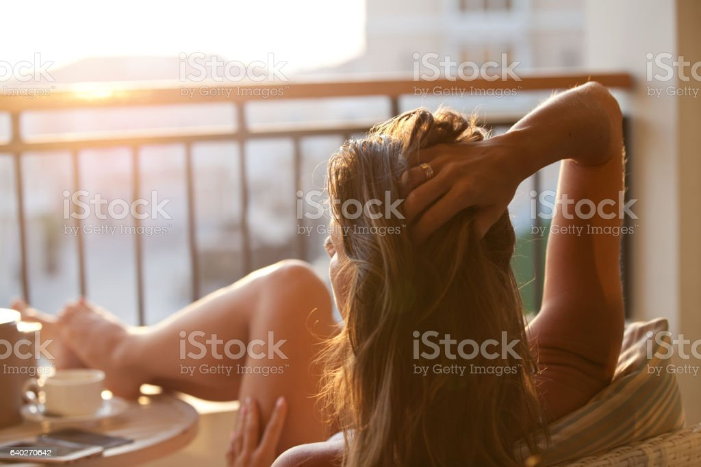 Woman relaxing enjoying sunrise. stock photo