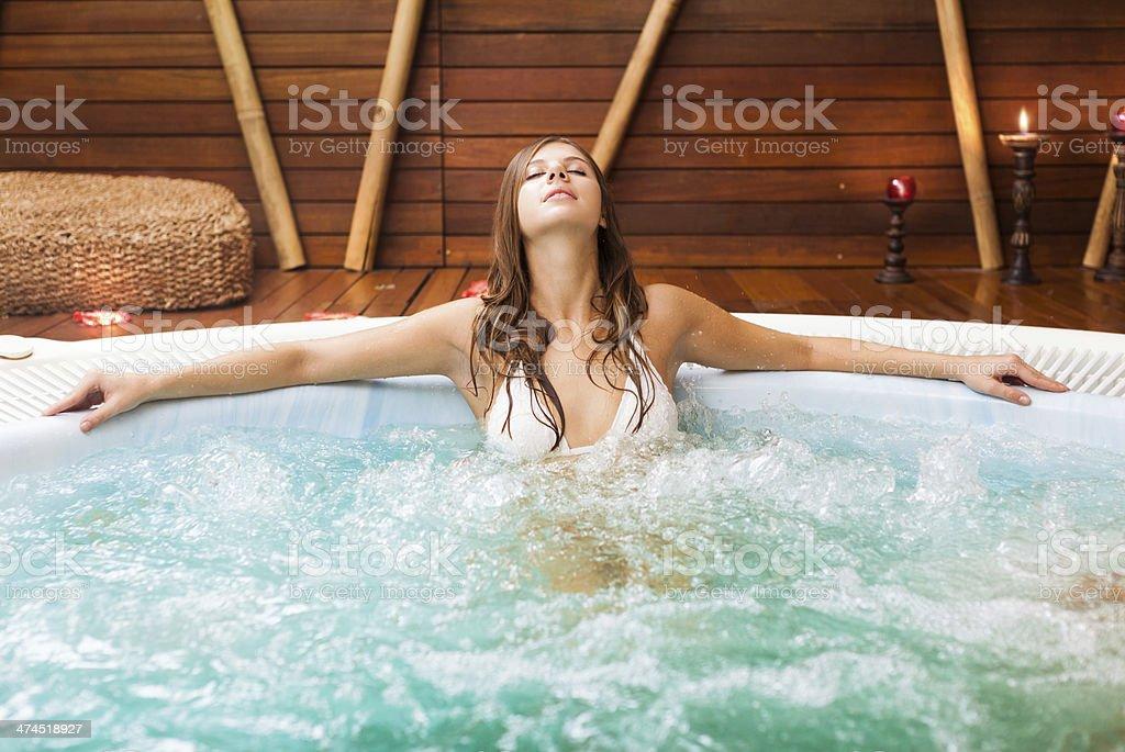 Woman relaxing in a beauty farm stock photo