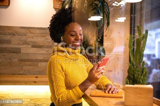 946192604 istock photo Woman relaxing in a cafè 1197852835