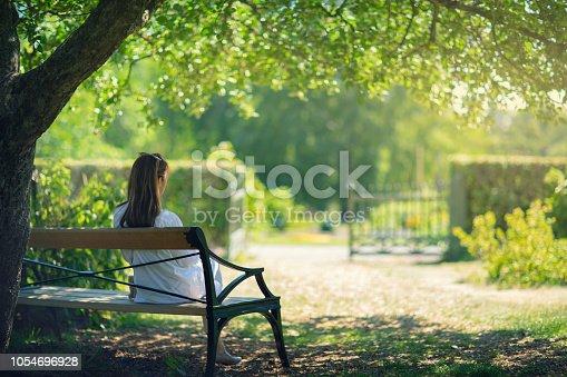 istock A woman relaxing in a green garden 1054696928