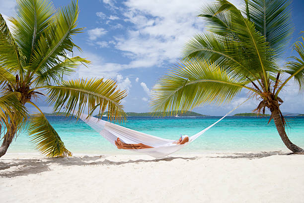 woman relaxing in a hammock at the Caribbean beach