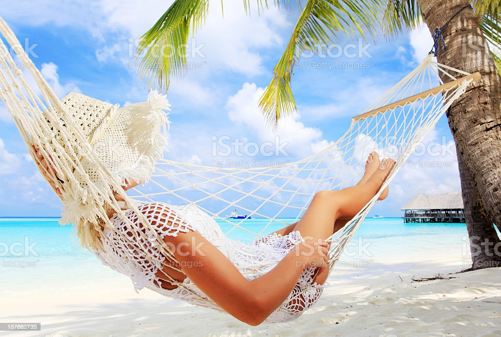 Woman relaxing in a hammock. stock photo
