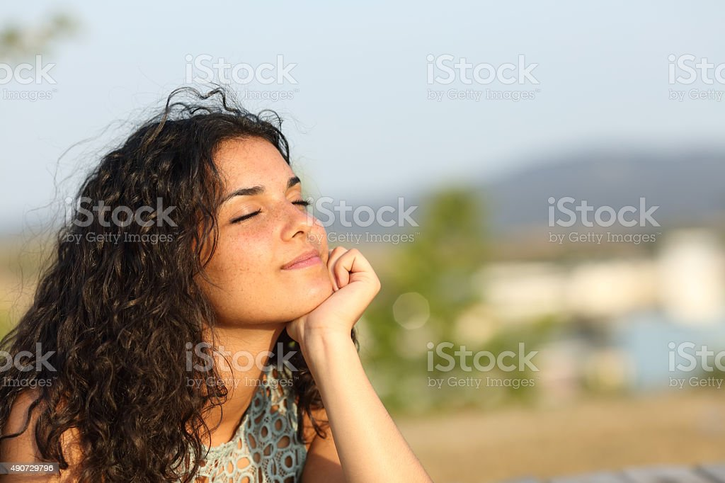 Woman relaxing in a warmth park stock photo