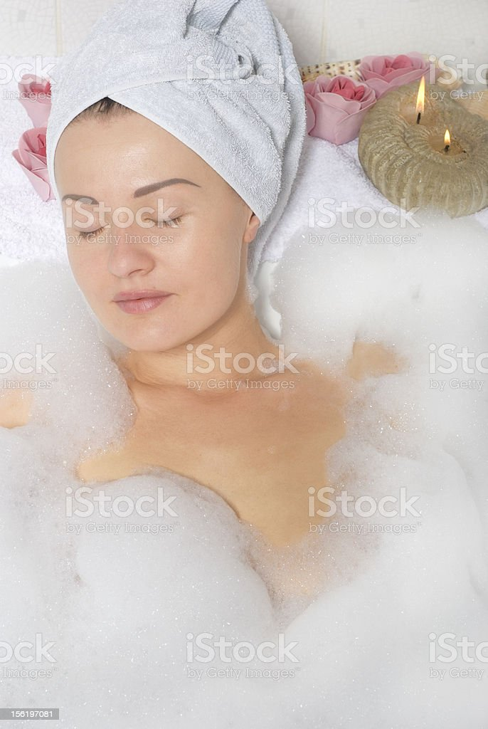 Woman relaxing in bathroom royalty-free stock photo