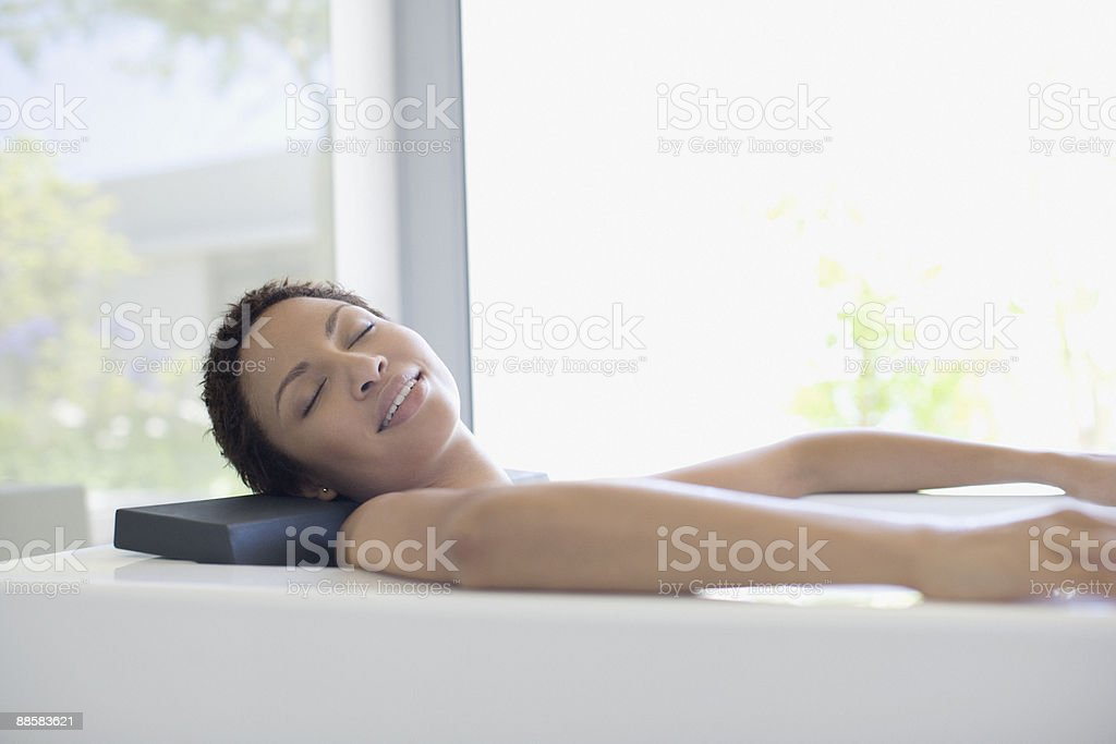 Woman relaxing in bathtub royalty-free stock photo