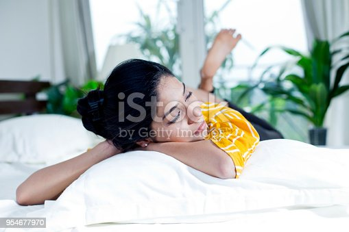 istock Woman relaxing in bed 954677970