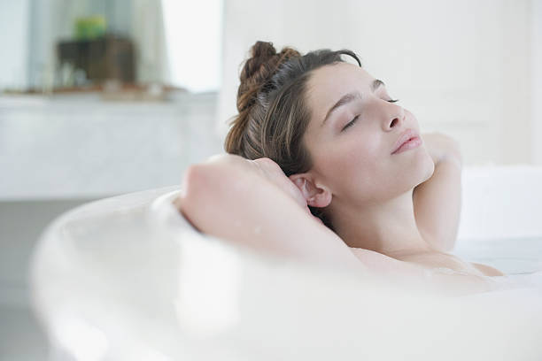 Woman relaxing in bubble bath  bubble bath stock pictures, royalty-free photos & images