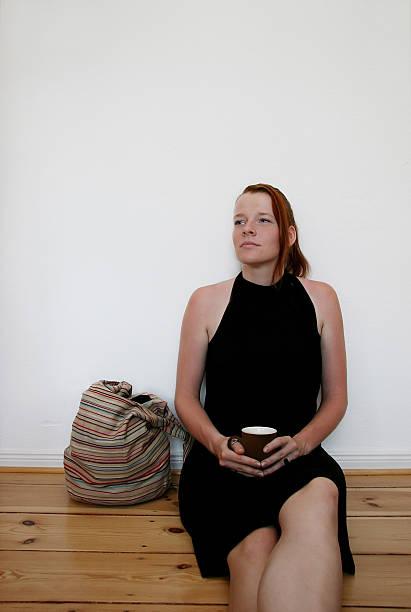 Woman relaxing in coffee break stock photo