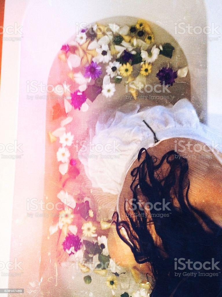 Woman relaxing in flower bath stock photo