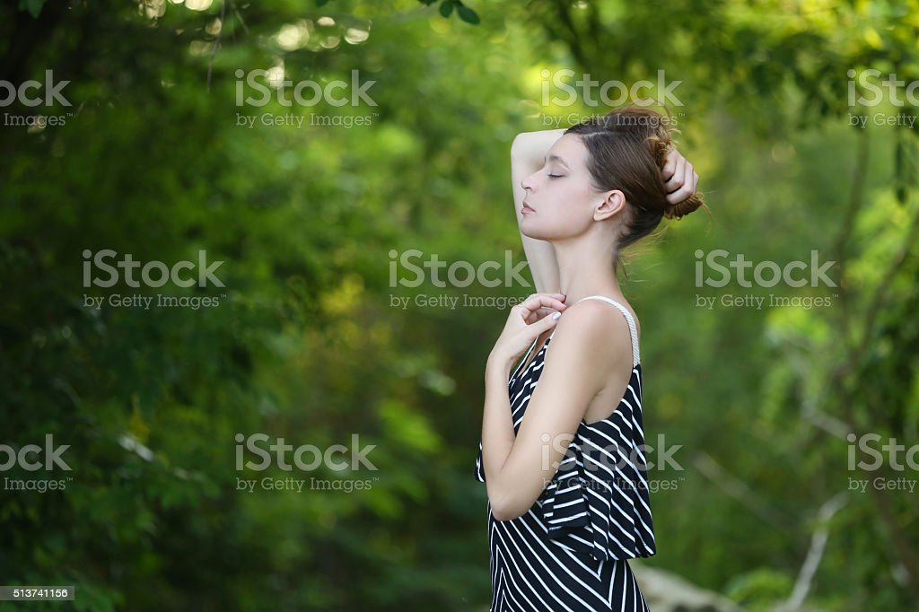 Woman relaxing in forest stock photo